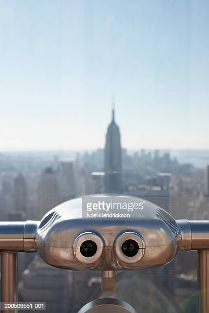 USA, New York, New York City, coin-operated binoculars and cityscape