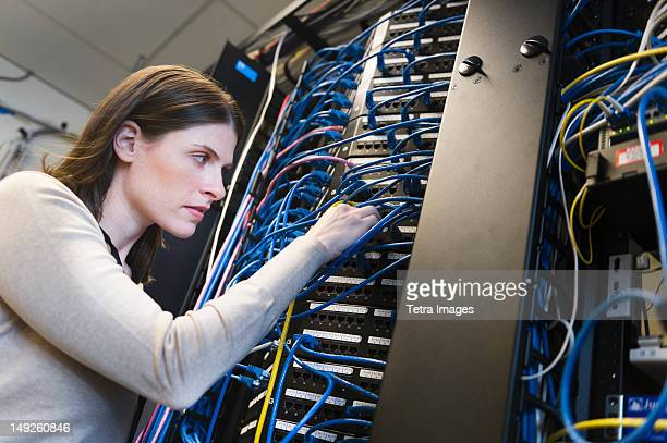 USA, New York, New York City, Female IT support technician repairing server