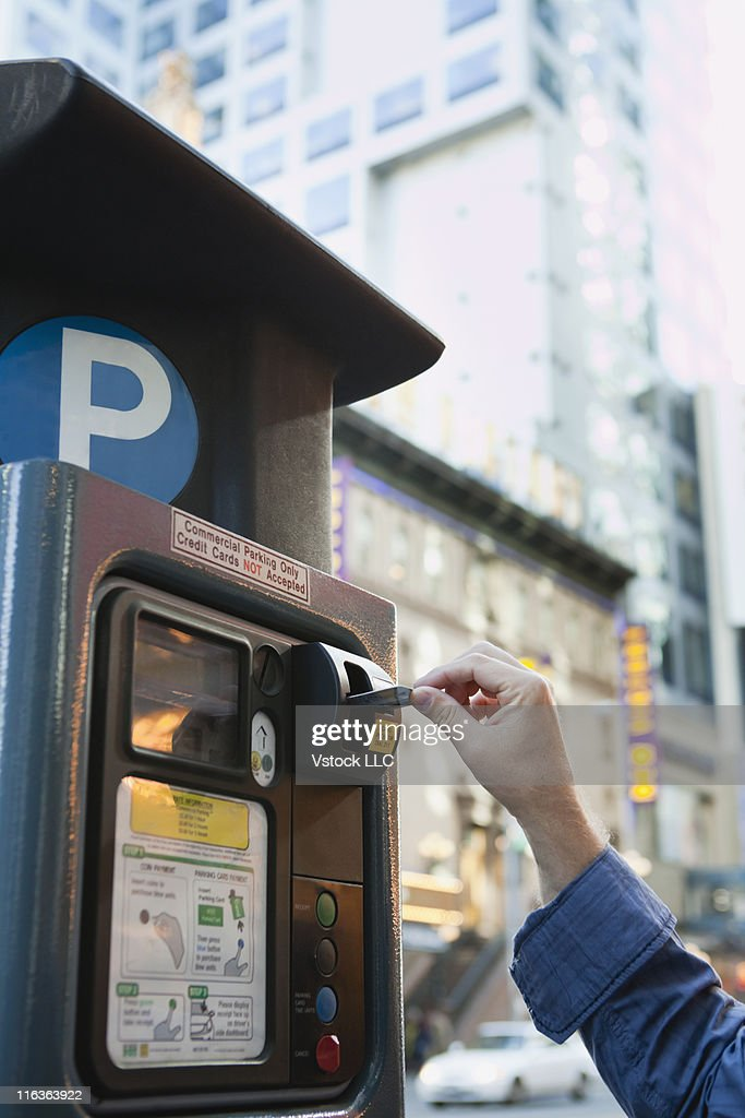 USA, New York, New York City, Man paying in parking machine