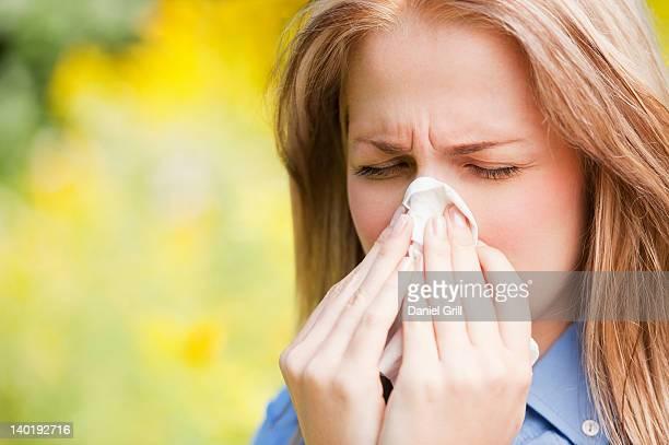USA, New York, New York City, Manhattan, Central Park, Close up of woman sneezing