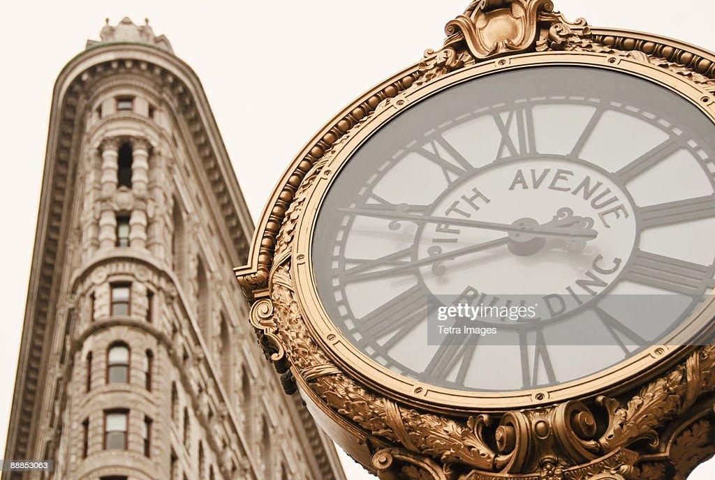 USA, New York, New York City, Manhattan, Flatiron Building and clock