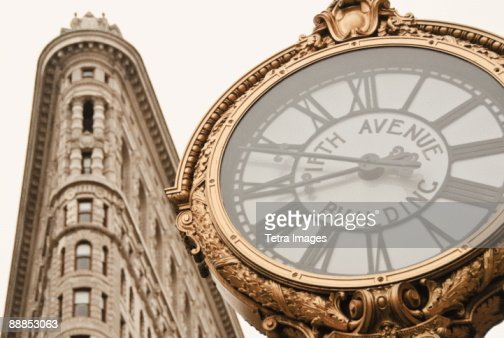 USA, New York, New York City, Manhattan, Flatiron Building and clock