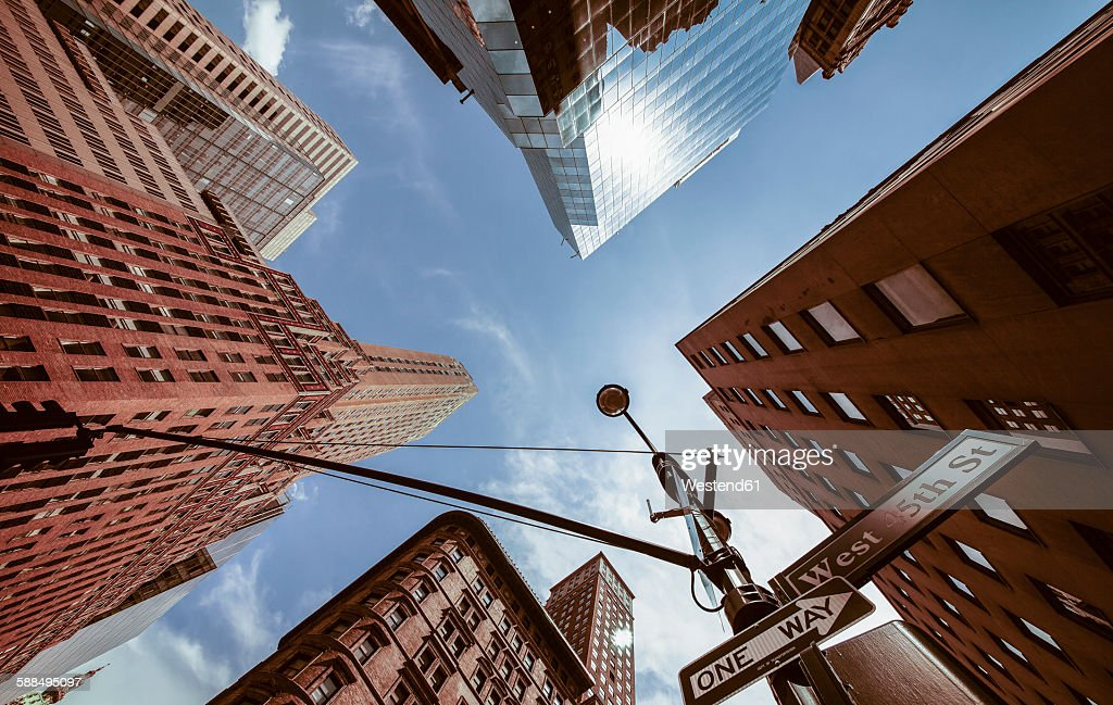USA, New York, New York City, Manhattan, Street corner, Signs 5th Avenue and West 45th Street, view from below