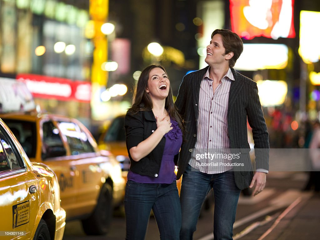 USA, New York, New York City, Manhattan, Times Square, young couple lauhing in street : Stock Photo