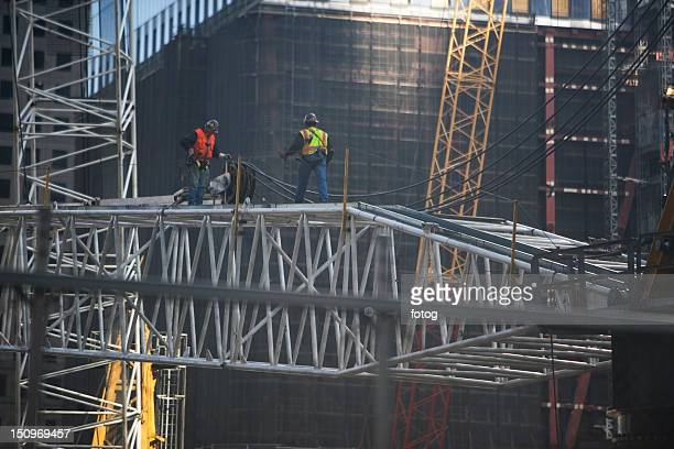 USA, New York, New York City, Manhattan, Workers on construction site