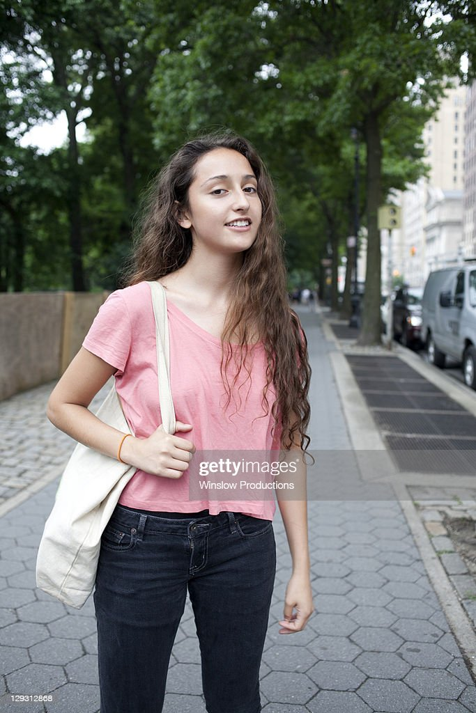 USA, New York, New York City, Portrait of smiling young woman standing on street : Stock-Foto