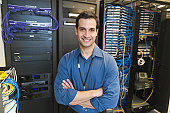 USA, New York, New York City, Portrait of technician in network server room