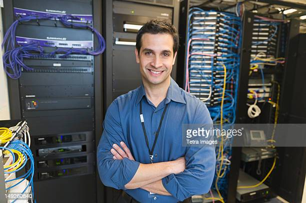 USA, New York, New York City, Portrait of technician in network server room