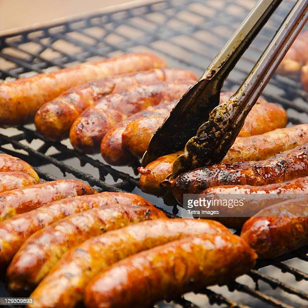 USA, New York, New York City, Sausages on barbeque