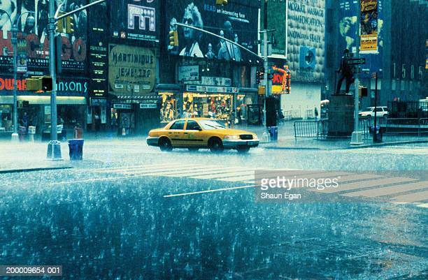 USA, New York, New York City, Times Square, taxi in rain