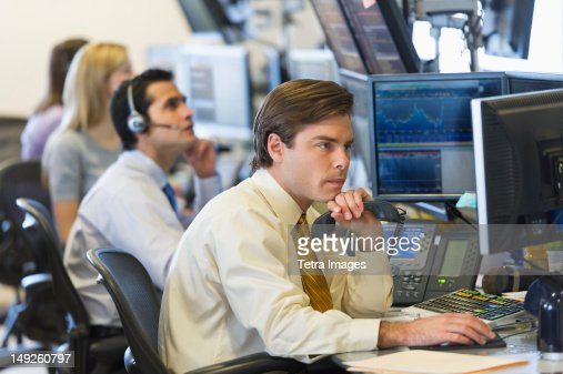 USA, New York, New York City, Traders at trading desk