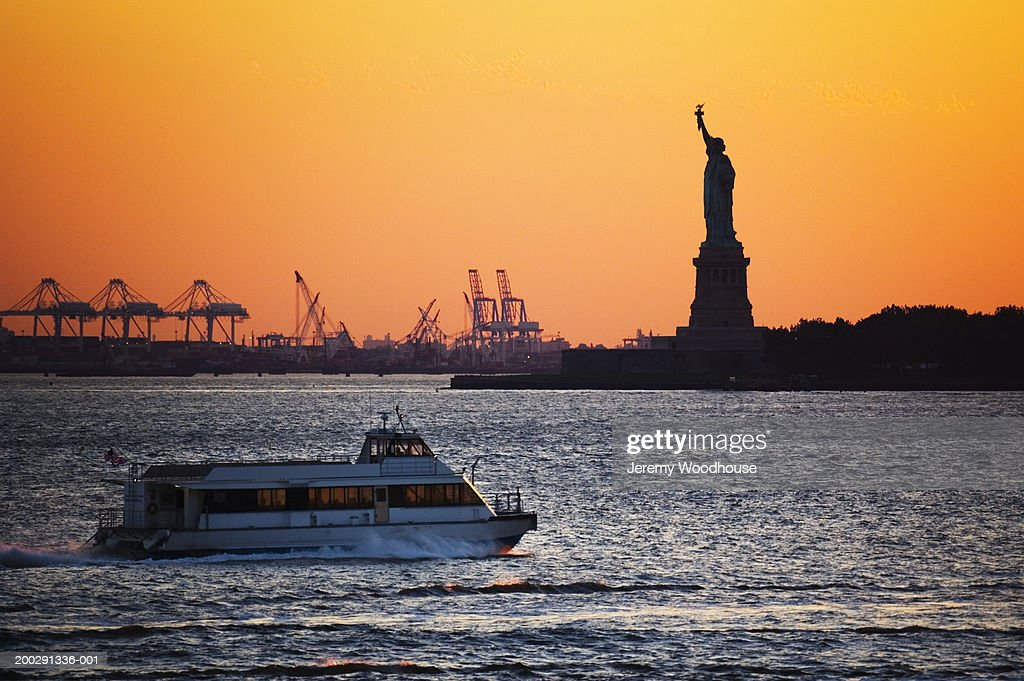 USA, New York, New York City, water taxi and Statue of Liberty