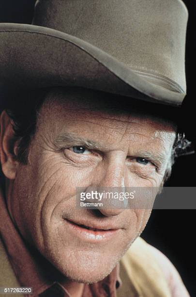 Jim Arness star of CBSTV's Gunsmoke is shown in a close up shot wearing a cowboy hat