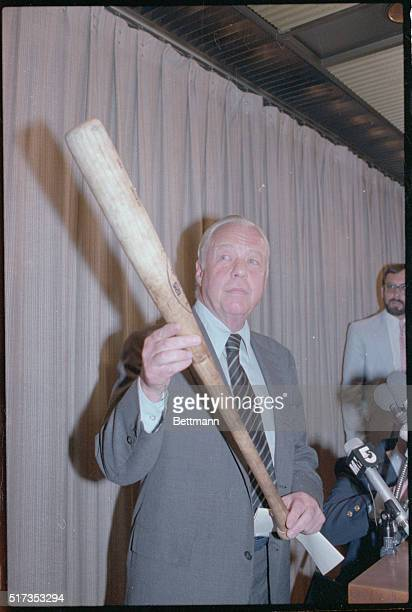Overruling his umpires American League President Lee MacPhail holds George Brett's 'pine tar' bat as he announces his decision 7/28 to let Brett's...