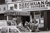 Police officials gather outside Szechuan Cuisine restaurant in Chinatown after gunmen opened fire at the restaurant Police said eight people were...