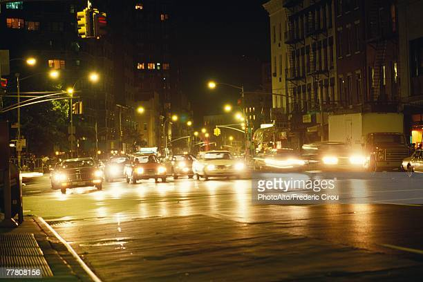 New York, New York, USA, cars pulling out from stoplight at night