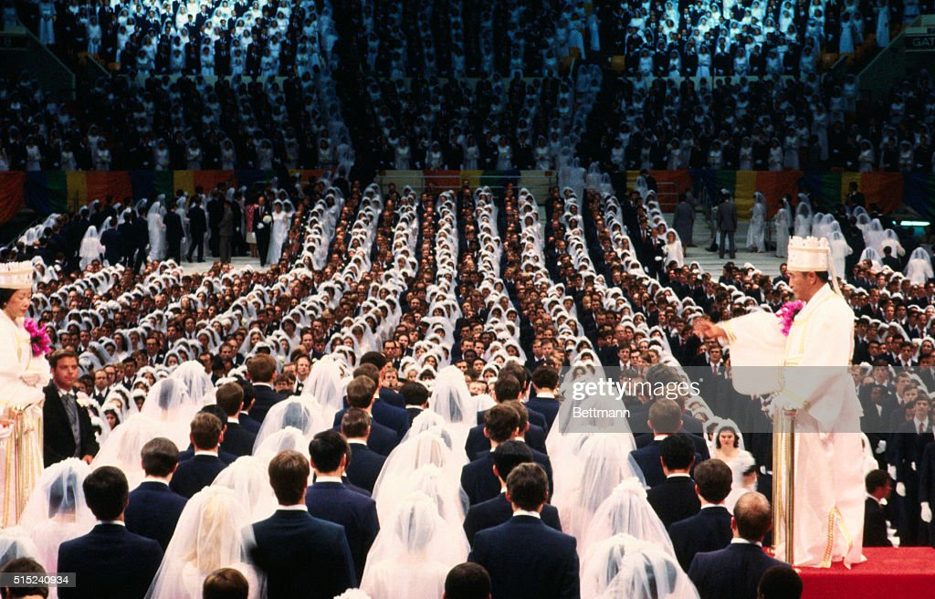 Wedding En Masse. Semi-general view of Madison Square Garden July 1 as some 22000 couples of Reverend <a gi-track='captionPersonalityLinkClicked' href=/galleries/search?phrase=Sun+Myung+Moon&family=editorial&specificpeople=773635 ng-click='$event.stopPropagation()'>Sun Myung Moon</a>'s Unification Church are wed en masse. Reverend Moon, his wife and other church officials are on raised platform in background.