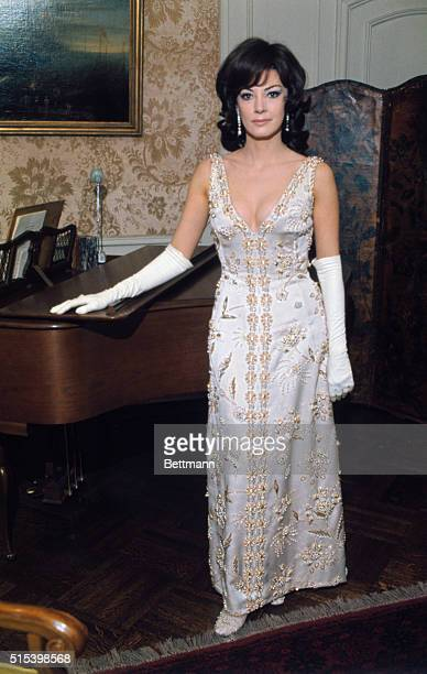 A principal topic of conversation following the White House dinner for the Romanian President was the low cut Valentino white evening gown worn by...