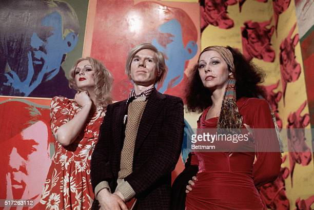 4/29/1971 New York NY Andy Warhol and superstars Candy Darling and Ultra Violet are shown at a press conference Andy is being interviewed in the...