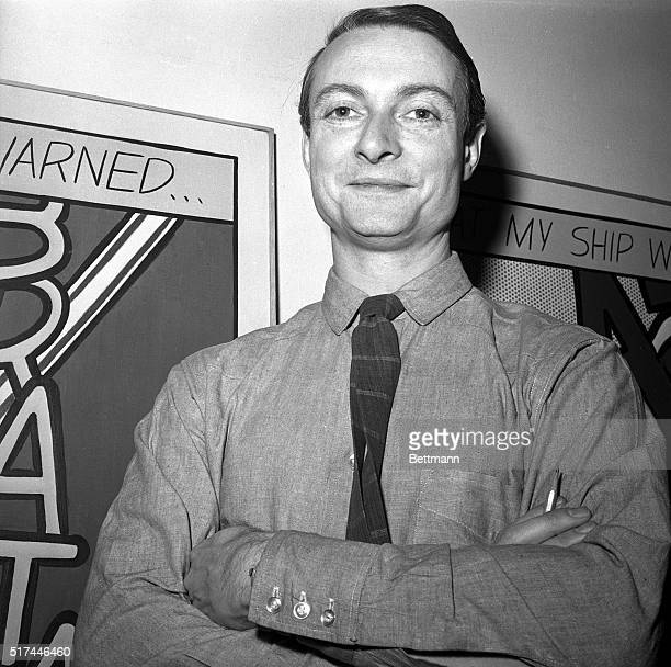3/13/1964 New York NY Closeup of artist Roy Lichtenstein with his arms folded standing in front of one of his famous comicbook inspired art works at...