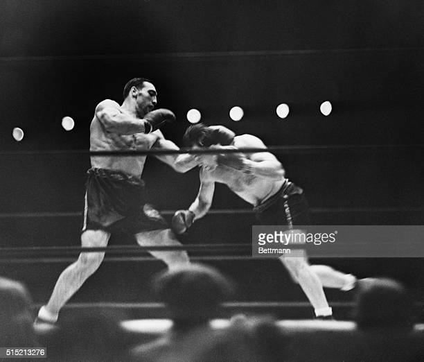 New York NY Jack Sharkey almost fell to the canvas when Primo Carnera landed this left at the nape of Jack's neck in the third round of their bout at...