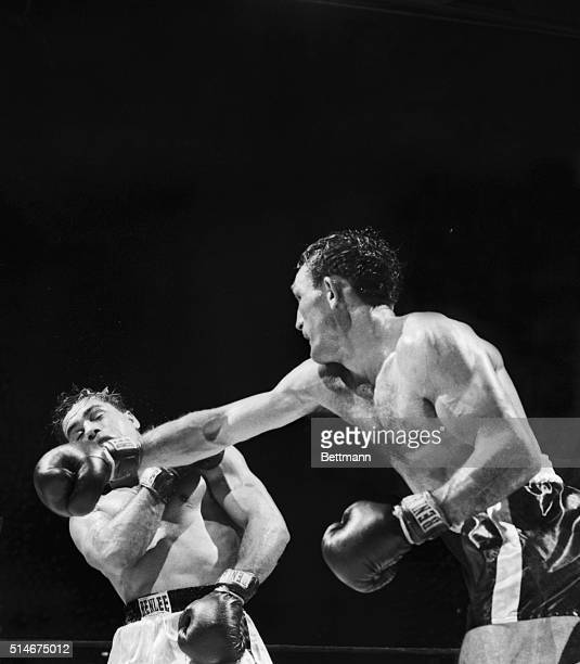 New York NY World Welterweight Champion Carmen Basilio slams a hard right at the face of Italo Scortichini in their nontitle tenround bout at Madison...