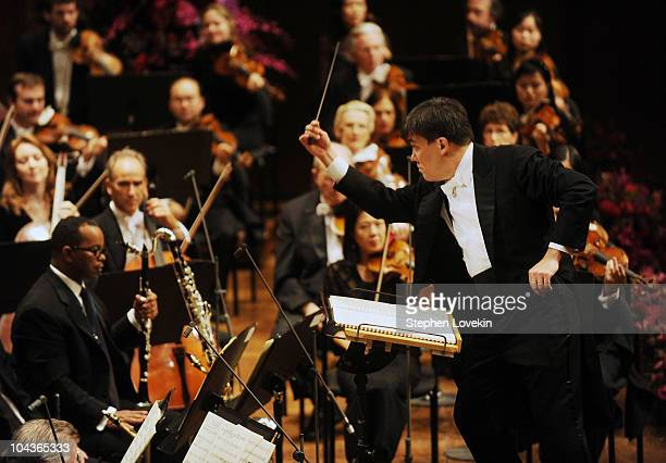 New York Philharmonic music director Alan Gilbert conducts the orchestra at the New York Philharmonic Opening Night Gala at Avery Fisher Hall at...