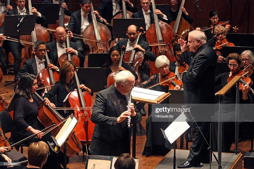 New York Philharmonic performing at Avery Fisher Hall on Thursday night, October 30, 2014.This image:Robert Langevin performing <a gi-track='captionPersonalityLinkClicked' href=/galleries/search?phrase=Christopher+Rouse&family=editorial&specificpeople=4159557 ng-click='$event.stopPropagation()'>Christopher Rouse</a>'s 'Flute Concerto' with the New York Philharmonic led by <a gi-track='captionPersonalityLinkClicked' href=/galleries/search?phrase=Leonard+Slatkin&family=editorial&specificpeople=226759 ng-click='$event.stopPropagation()'>Leonard Slatkin</a>.