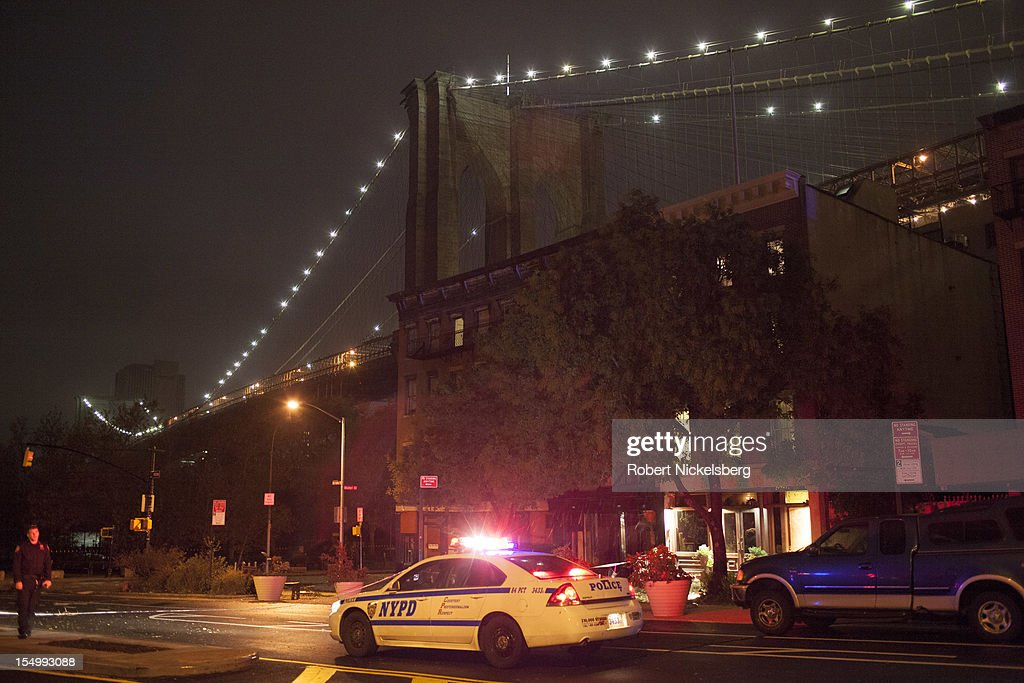 A New York Police car monitors the water level after Hurricane Sandy hit on October 29, 2012 inah the Brooklyn borough of New York. Electricity in Lower Manhattan had been turned off. The storm, which threatens 50 million people in the eastern third of the U.S., is expected to bring days of rain, high winds and possibly heavy snow.