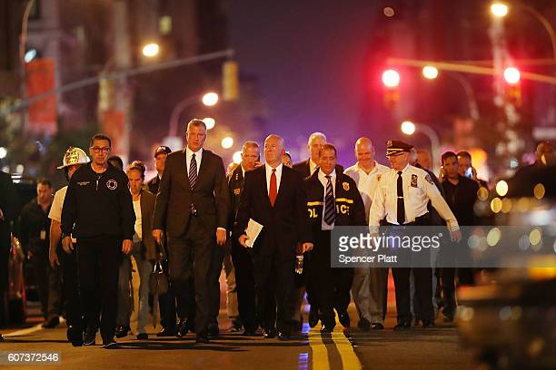 New York Police Commissioner James O'Neill and Mayor Bill de Blasio walk into a press conference as police firefighters and emergency workers gather...