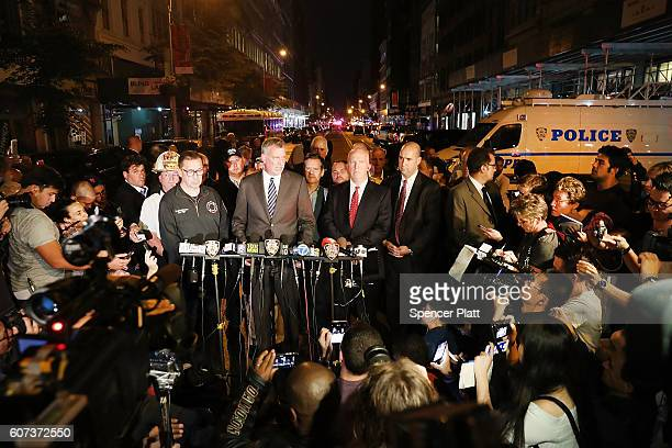 New York Police Commissioner James O'Neill and Mayor Bill de Blasio speak at a press conference as police firefighters and emergency workers gather...