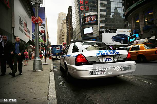 New York Police Department car sits parked in Times Square on August 12 2013 in New York City The controversial policy employed by the NYPD in high...