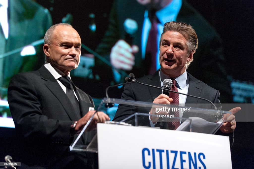 New York Police Department commissioner Raymond W. Kelly (L) looks on as Alec Baldwin speaks on stage during the New Yorker For New York Gala 2013 at Gotham Hall on February 25, 2013 in New York City.