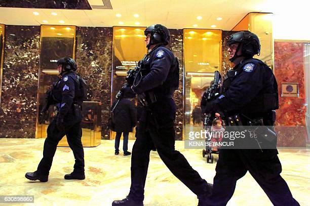 New York Police Department counterterrorism officers patrol inside the Trump Tower on January 3 2017 in New York / AFP / KENA BETANCUR