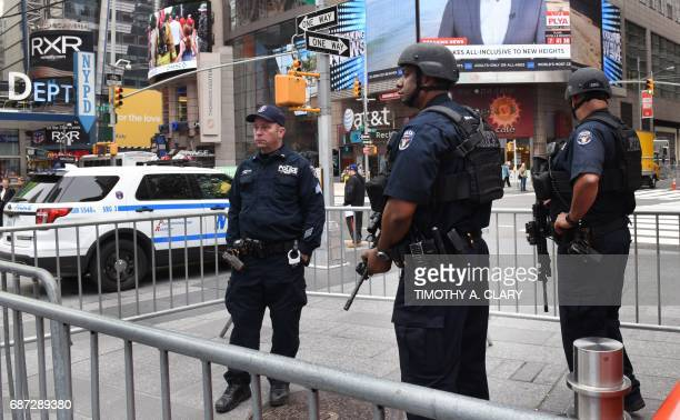 New York Police Department Counterterrorism units patrol Times Square in New York City on May 23 2017 the morning after the Islamic State group...