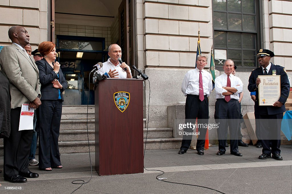New York Police Department Inspector <a gi-track='captionPersonalityLinkClicked' href=/galleries/search?phrase=Rodney+Harrison&family=editorial&specificpeople=211203 ng-click='$event.stopPropagation()'>Rodney Harrison</a>, New York City mayor Michael R. Bloomberg, Manhattan District Attorney Cyrus R. Vance, Jr., New York City Police Commissioner Raymond W. Kelly, and New York City Council Speaker Christine C. Quinn attend National Night Out on the streets of Manhattan on August 7, 2012 in New York City.