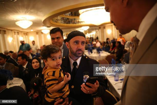 New York Police Department officer Chaplin Khalid Latif attends an iftar dinner within the holy month of Ramadan in Queens borough of New York United...