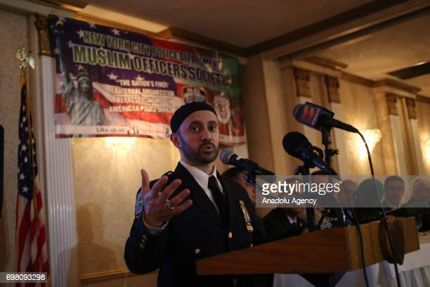 New York Police Department officer Chaplin Khalid Latif speaks during an iftar dinner within the holy month of Ramadan in Queens borough of New York...