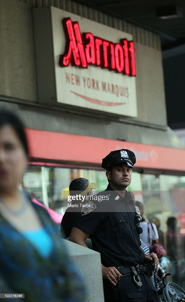 A New York Police Department officer keeps watch outside the Marriott Marquis hotel in Times Square on June 21, 2010 in New York City. Accused Times Square bomber Faisal Shahzad is slated to be arraigned this afternoon on ten counts of terror and weapons charges.