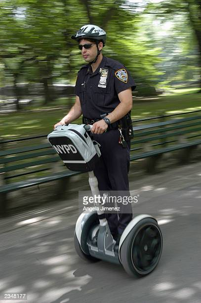 New York Police Department officer Salvatore Maniscalco demonstrates the use of the Segway Human Transport in Central Park July 30 2003 in New York...