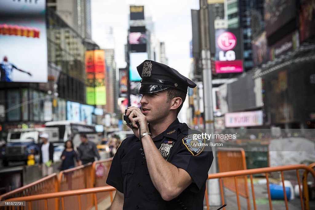 New York Police Department officer speaks on his radio in Times Square on September 22 2013 in New York City The NYPD announced that they would be...