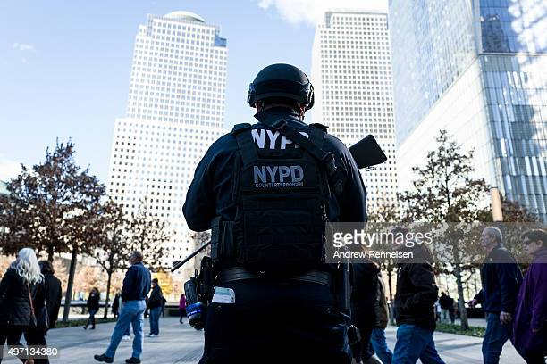 New York Police Department officer stands guard outside of the 9/11 Memorial following a series of terrorist attacks in the French capital on...