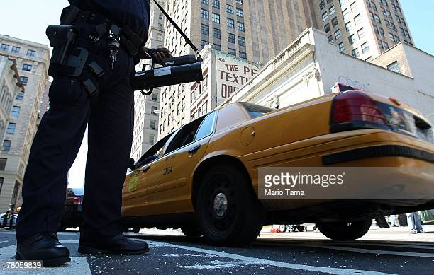 New York Police Department officer uses a radiation detection device to monitor traffic following a 'dirty bomb' threat August 11 2007 in New York...