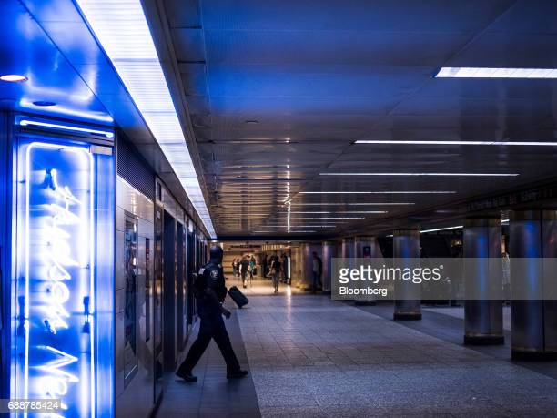 A New York Police Department officer walks through the Long Island Railroad Co concourse inside Pennsylvania Station in New York US on Friday May 26...