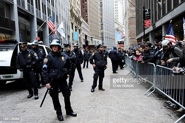 New York Police Department officers barricade the street against demonstrators with 'Occupy Wall Street' a few blocks from the New York Stock...