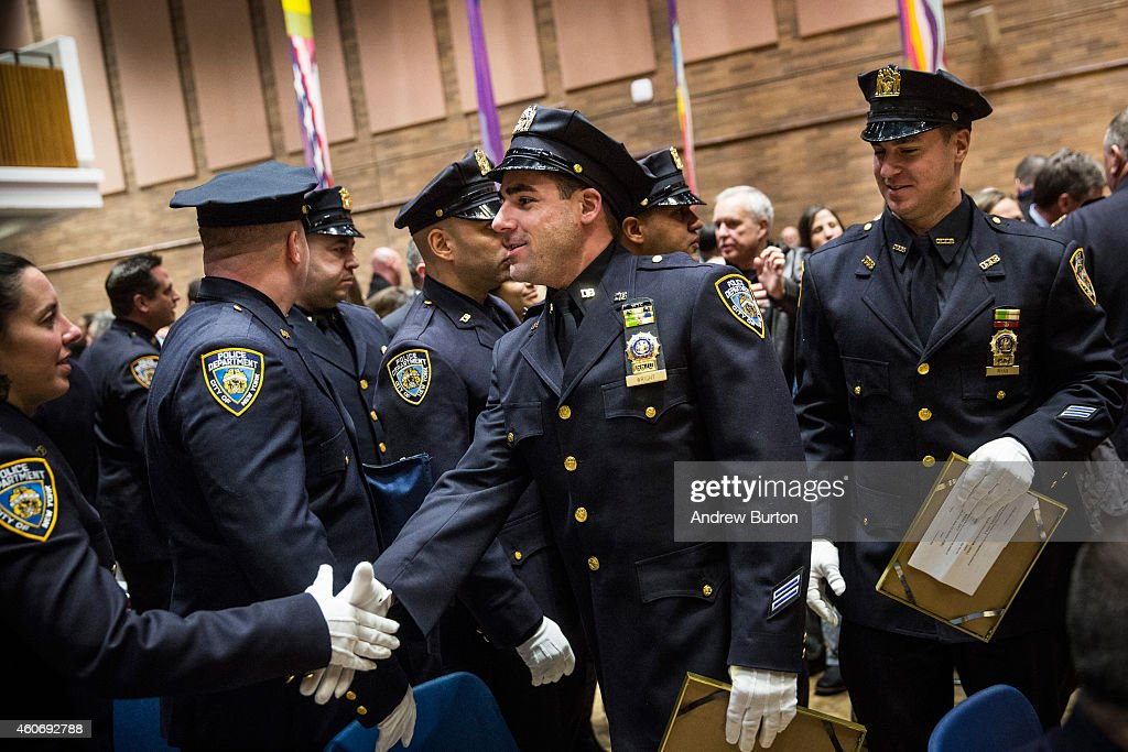 new york police department officers congratulate each other after a promotion ceremony on. Black Bedroom Furniture Sets. Home Design Ideas