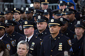 New York Police Department officers from the 79th precinct stand outside before the funeral of slain NYPD officer Rafael Ramos at the Christ...
