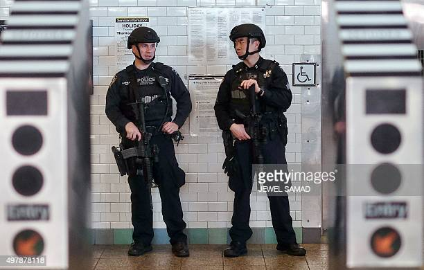 New York Police Department officers guard an entrance of a subway at the Times Square in New York on November 192015 AFP PHOTO/JEWEL SAMAD