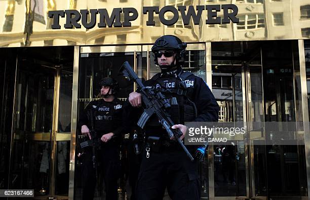 New York Police Department officers guard the main entrance of the Trump Tower where US Presidentelect Donald Trump holds meetings in New York on...
