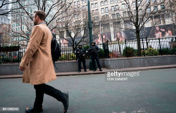 New York police department officers patrol the area around Herald Square on December 12 2017 in New York The United States unveiled federal terrorism...